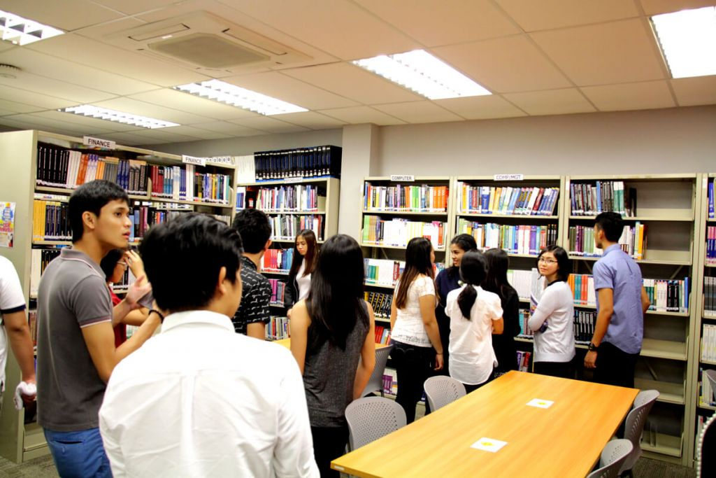 Students from University of Santo Thomas touring TMC Academy's library