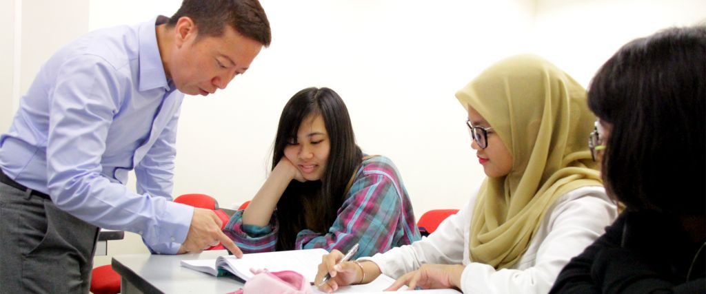 Alex with students - TMC Academy Laying Strong Foundation for Studies